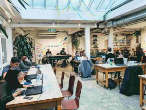 People coworking for Husk Creative and Coffee, a charity run free workspace